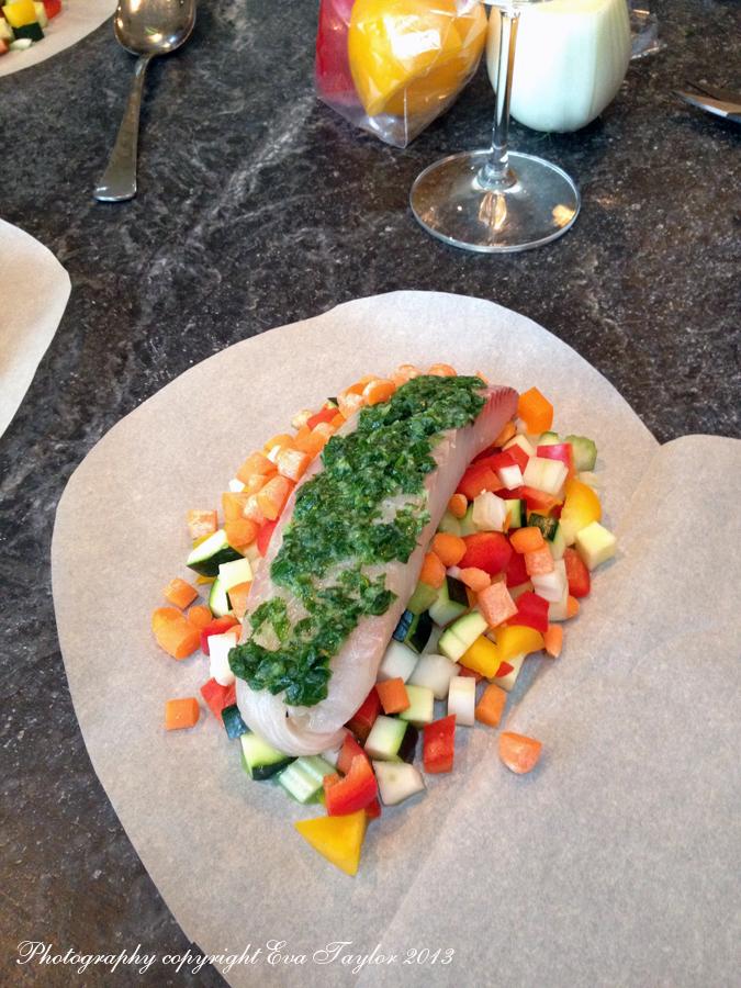 Add the fish, white wine and season.
